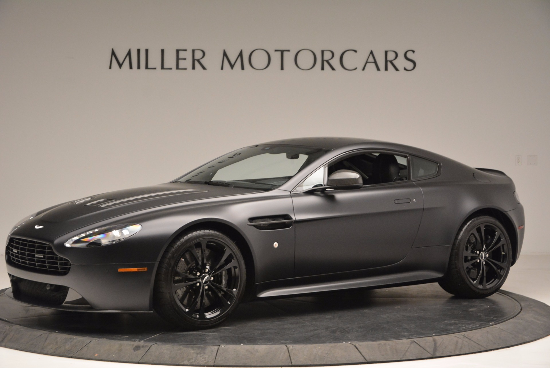 Pre Owned 2012 Aston Martin V12 Vantage Carbon Black For Sale Special Pricing Aston Martin Of Greenwich Stock A1214a